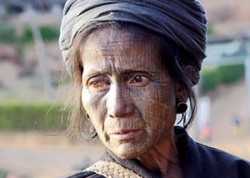 Chin woman with face tattoo